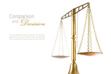 justice scales: vintage brass scales of justitz isolated on a white background, concept comparsion and decision, closeup shot with selected focus and narrow depth of field