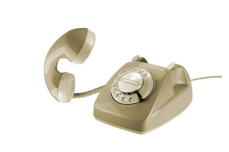 removed: Vintage rotary dial phone in beige with removed telephone receiver isolated on a white background Stock Photo