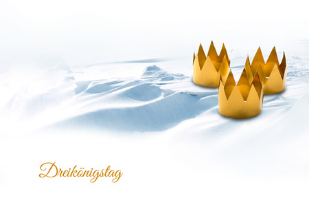 tinkered: Epiphany, symbolized by three tinkered crowns on a snowy background, german text Dreiköningstag, that means Three Kings Day