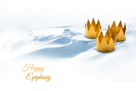 caspar: Epiphany, Three Kings Day, symbolized by three tinkered crowns on a snowy background, text Happy Epiphany Stock Photo