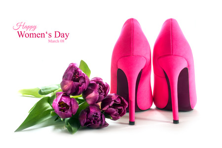 Ladies pink high heel shoes from behind and tulips isolated with shadows on a white background, concept symbol for love, sample text Happy Womens Day March 08, selected focus