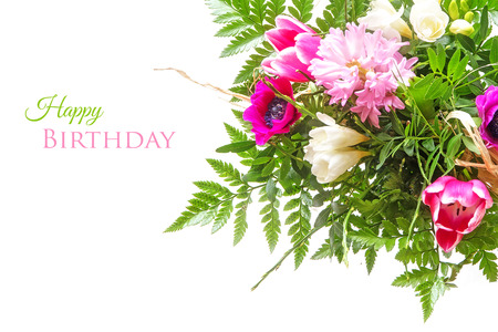 sample text: colorful bouquet of spring flowers isolated on white as a corner background, sample text in the copy space: happy birthday
