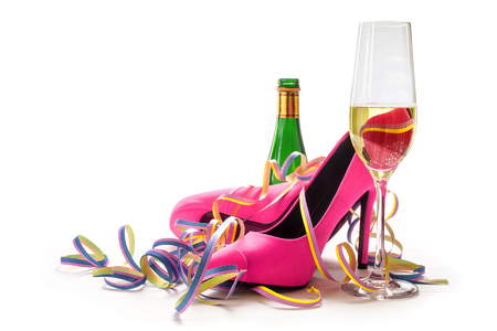women's day, ladies pink high heels shoes, champagne and streamers for a cheerful party, isolated on a white background, selected focus