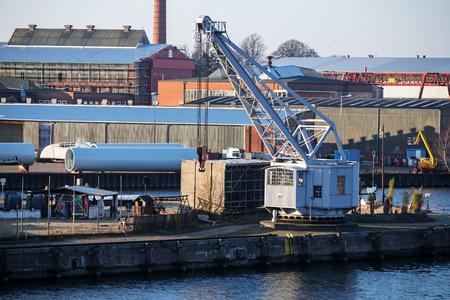 dockyard: cargo port scene with an old dockyard crane on the pier.
