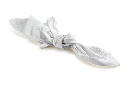 reminder, knot in handkerchief of white cloth, isolated with shadow on a white background, concept for remember and dementia