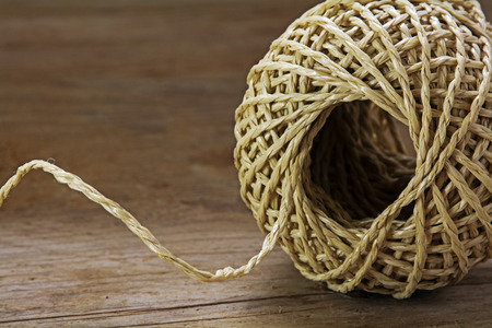 strands: Ball of string with texture and strands on a wooden background, close up shot, selected focus Stock Photo