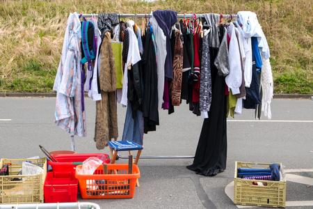 used clothes: used clothes hanging on a rack for sale at a weekend flea market