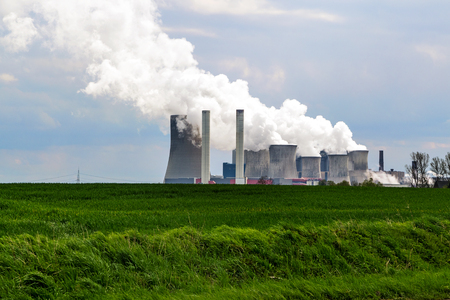 plant nature: lignite fired power station behind a agricultural field landscape, Niederaussem, Germany, issued in May 2007 by the WWF as the third-worst power station in Europe in terms of the relation of energy efficiency to CO2 emissions