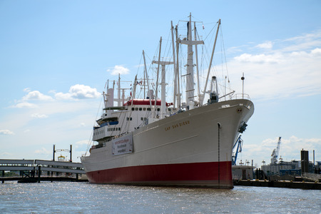 st pauli: Hamburg, Germany - June 11, 2016: MS Cap San Diego against the blue sky, a restored general cargo ship, situated as a museum ship in Hamburg - St Pauli, Germany