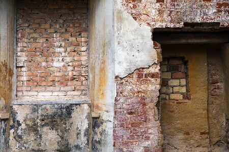 refurbish: different structures and textures of brick masonry and plaster in a ruin, lost place background with copy space