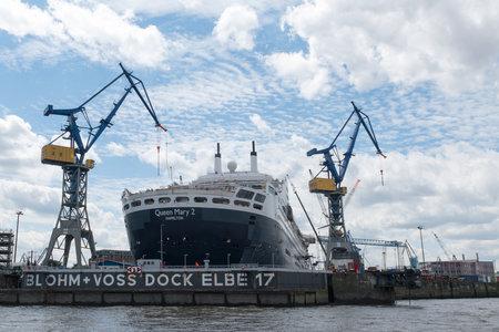 dockyard: Hamburg, Germany - June 11, 2016: RMS Queen Mary 2, the transatlantic ocean liner in the dockyard Blohm and Voss in the port of Hamburg