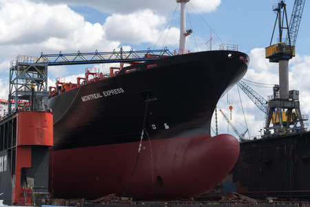 drydock: Hamburg, Germany - June 11, 2016: the bulbous bow of the container ship Montreal Express in dry dock in the cargo port of Hamburg Editorial