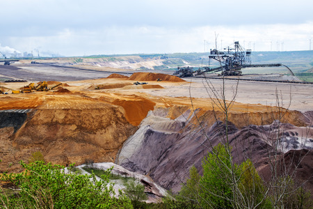 lignite: destroyed earth layers during lignite (brown coal) open pit mining at Garzweiler, Germany, significant impact on the environment