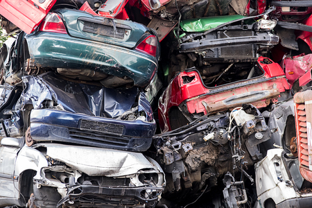 dump yard: pile of discarded scrap car on a junkyard, concept for insurance or waste management Stock Photo
