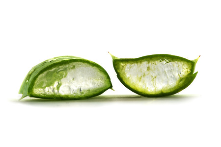 Two slices of a fresh aloe vera leaf with the transparent gel inside, used for medicinal purposes, skin treatment and cosmetics, macro shot  isolated with shadows on a white background, selective focus, narrow depth of field