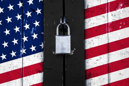 savety: United states of america flag painted on a wooden door and locked with a padlock, political concept background, symbol for protectionism  Stock Photo
