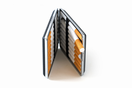the case selected: Cigarette case with tobacco filter cigarettes isolated with small shadows on a white background, selected focus