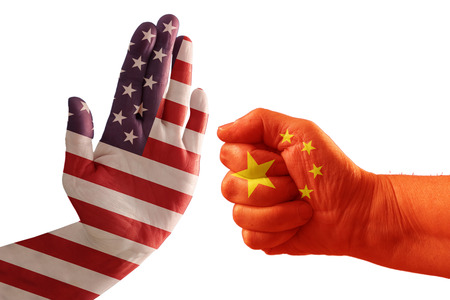 Trade conflict, USA flag on a stop hand and China flag on a fist, isolated against a white background Stock Photo