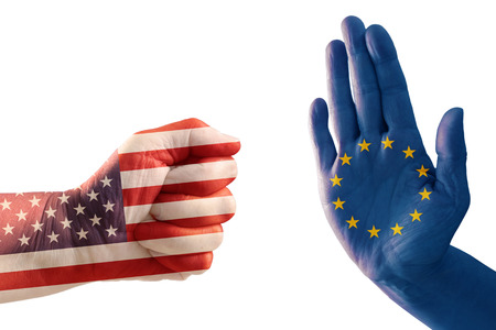 trade conflict, fist with USA flag against a hand with European flag, isolated on a white background