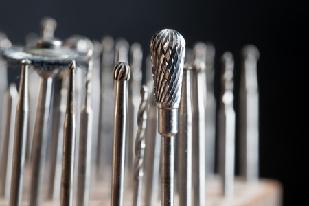 Milling heads on a goldsmith workplace, macro shot of  jewelry tools against a dark background, selected focus, narrow depth of field