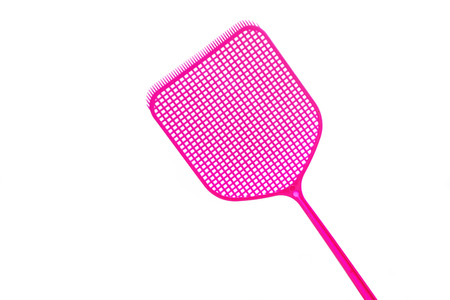 Pink flyswatter from plastic isolated on a white background, copy space