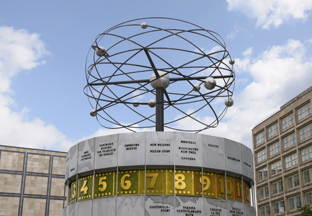 Urania World Clock with planets against a blue sky in the public square of Alexanderplatz in Mitte, Berlin