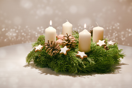 Second Advent - decorated Advent wreath from fir and evergreen branches with white burning candles Archivio Fotografico