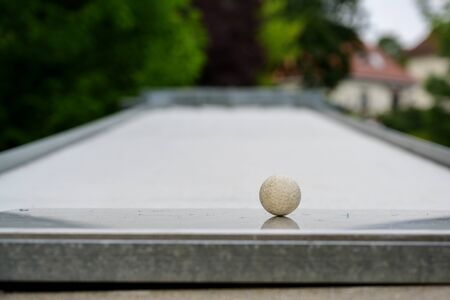 Ball as close-up shot on a miniature golf course, copy space