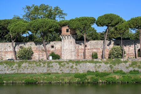 Tower and wall of the Cittadella Nuova (New Citadel), now called Giardino Scotto (Scottos Garden) an old fortress in Pisa at the river Arno, Italy