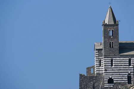Saint Peters Church (Chiesa di San Pietro) against the clear blue sky with large copy space, famous landmark in Porto Venere, the coast village on the Gulf of Poets between La Spezia and Cinque Terre, Liguria, Italy
