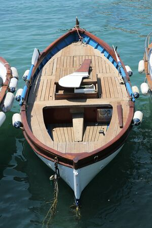 wooden boat in the harbour on the mediterranean sea