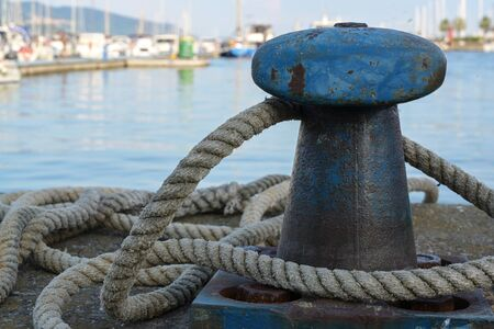 Bollard from iron with a ship rope at the pier on the port Stock fotó