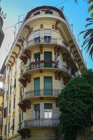 Corner house in a narrow street in the capital city La Spezia, Liguria, Italy Stock Photo