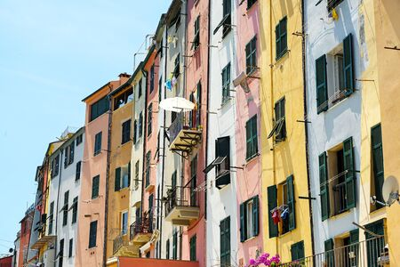 Colorful house facades with balconies and typical shutters in the old town of portovenere, liguria, italy