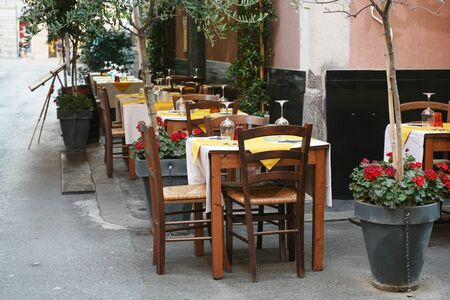 Table setting on the street from a rustic restaurant in the old town of the capital city La Spezia, Liguria, Italy