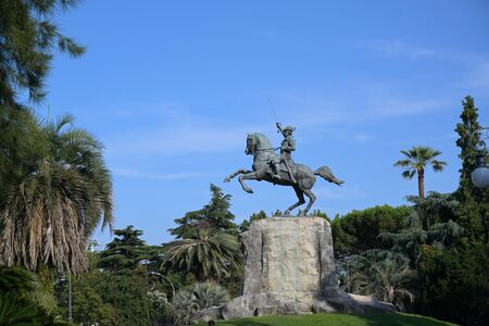 Giuseppe Garibaldi Equestrian Monument, bronze statue between palm trees in the public park of the capital city La Spezia, Liguria, Italy