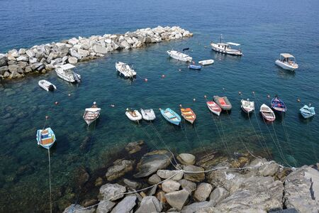 Leisure boats in a rocky natural harbor in the Mediterranean sea in italy, aerial view from above Stock fotó