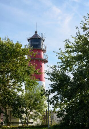 Lighthouse in the city of Buesum, famous tourist resort on the North Sea coast
