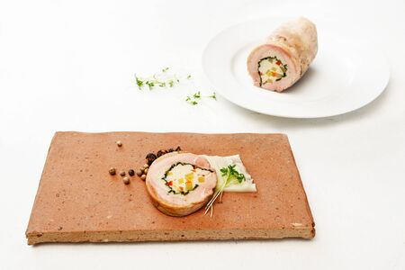 Guail galantine, de-boned stuffed meat as a cold appetizer for a festive dinner