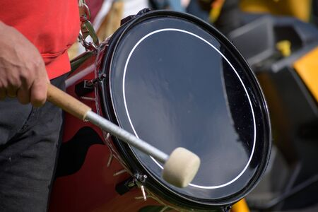 musician plays the kettledrum in a corps of drums, selected focus, motion blur