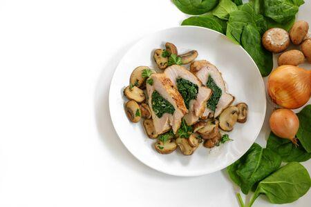 Chicken breast fillet with spinach filling, mushrooms Banco de Imagens