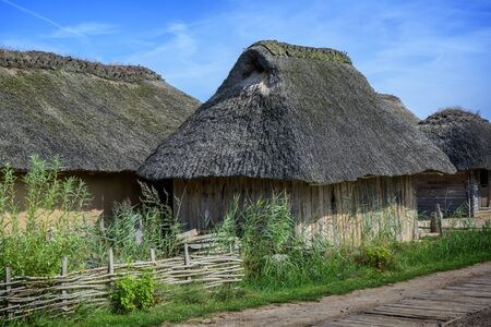 Historical wooden house with thatched roof