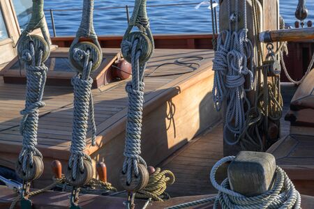 Rigging, ropes and knots on a historical wooden sailing ship on a sunny day on the sea Stok Fotoğraf