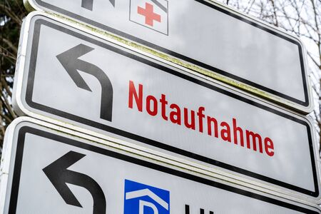 Direction sign shows the Red Cross and German text Notaufnahme, meaning emergency department