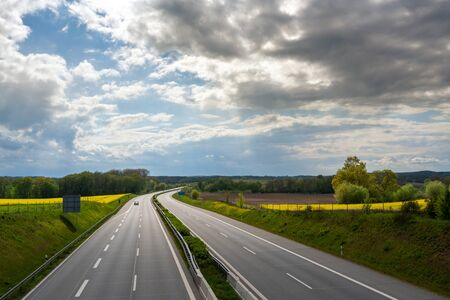 Almost empty highway with only one car during lockdown 스톡 콘텐츠 - 148502410