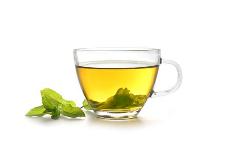 herbal tea made from fresh peppermint leaves in a glass cup isolated on a white background, copy space Stock Photo