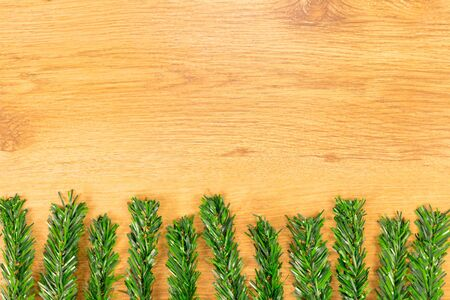 Christmas decoration on wooden background. Top view with space for your text.