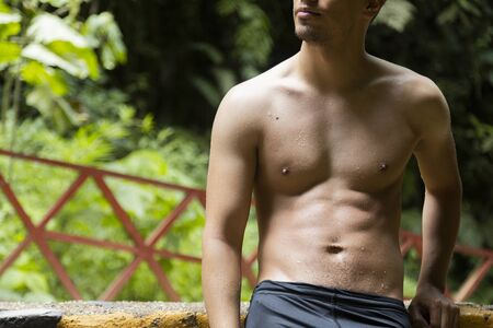 Hispanic Hispanic man in hot springs relaxing in Guatemala