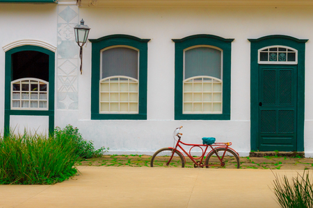 red oil lamp: Bicycle parked in front of an old house in the historic city of Paraty, RJ, Brazil.