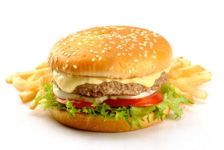 sandwich with burger, mayonnaise, cheese, tomatoes, salad and chips